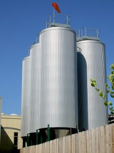 Grain tanks outside Dogfish Head Brewery