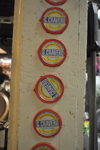 Tags from Cravero wheels cracked on the Formaggio cheese counter