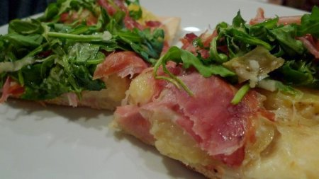 Potato, speck, garlic, Fontal, parm and arugula pizza