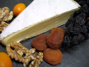 Brie with Kumquats, Walnuts, Raisins on the Vine and Apricots