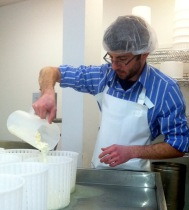 Brad Pouring Curds at Mt. Mansfield Creamery