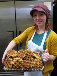 Alyssa with a basket of her Belgian waffles.