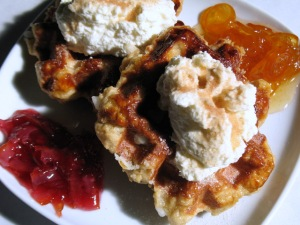 Belgian or Liège Waffles with cream, cinnamon sugar and preserved fruits.