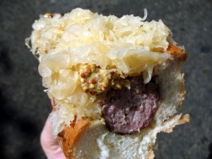 Eating Julie's Fennel Garlic Sausage with Arrowhead Cabbage Sauerkraut and Moutarde à l'Ancienne